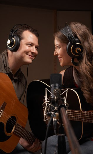 Stock Photo: 1828R-28863 Musicians Playing Guitar in Recording Studio