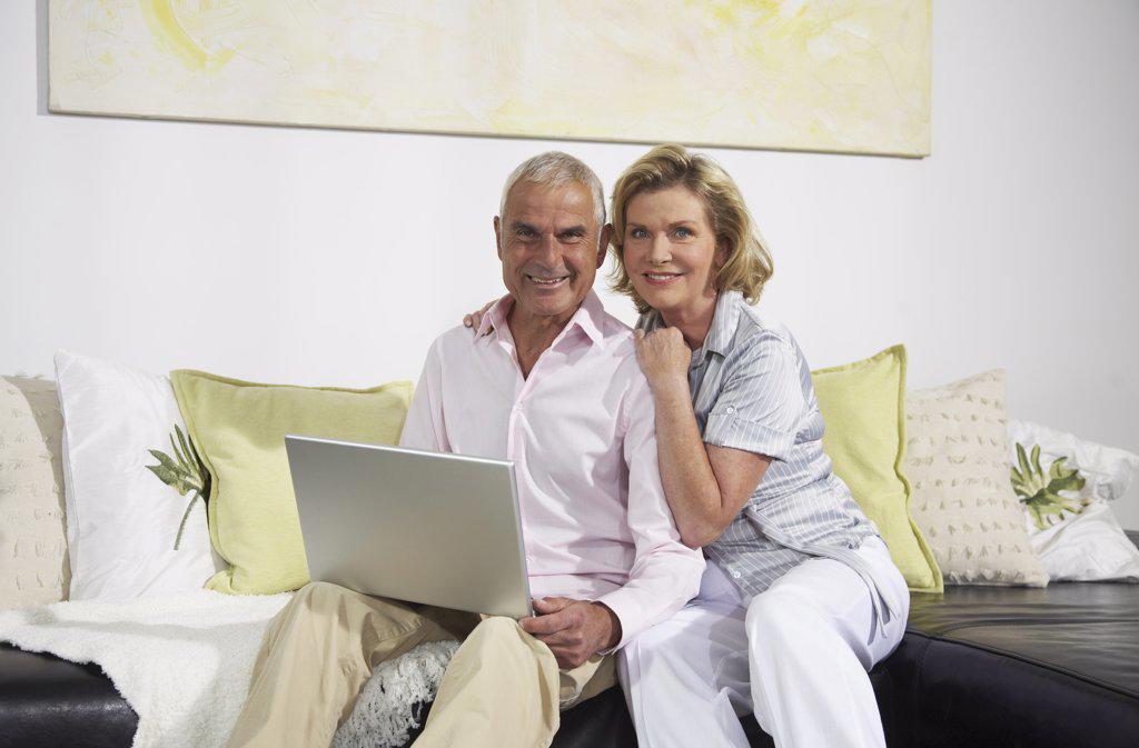 Couple Using Laptop    : Stock Photo