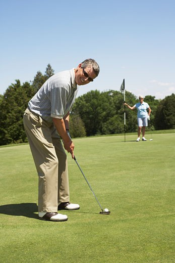 Stock Photo: 1828R-29300 Couple Golfing