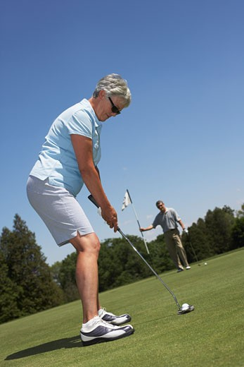 Stock Photo: 1828R-29302 Couple Golfing