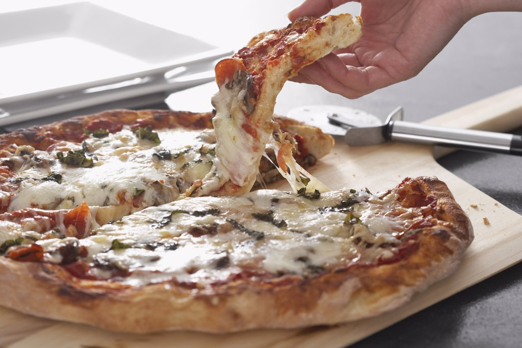 Stock Photo: 1828R-29442 Cutting Pizza
