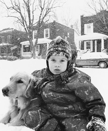 Stock Photo: 1828R-3014 Portrait of Boy with Dog Outdoors In Winter