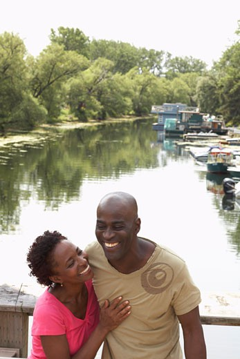 Stock Photo: 1828R-30520 Couple by River