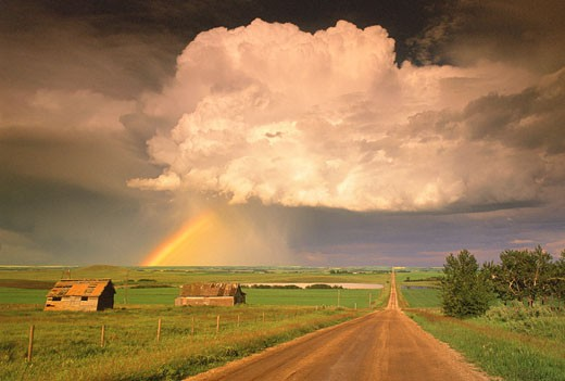 Stock Photo: 1828R-3058 Rainbow and Passing Storm Airdrie, Alberta, Canada