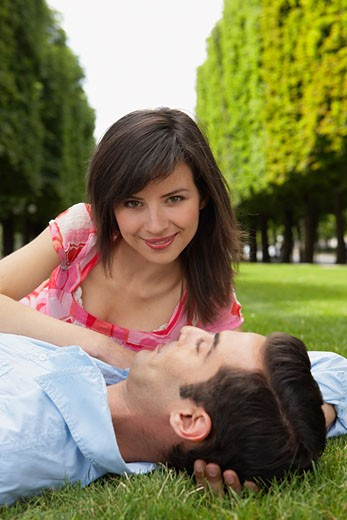 Stock Photo: 1828R-30744 Couple Lying Down at Park