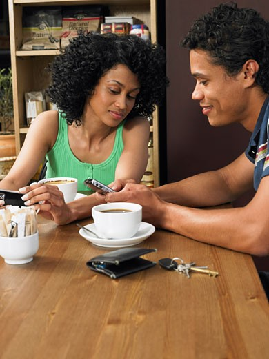 Stock Photo: 1828R-30866 Couple in Cafe