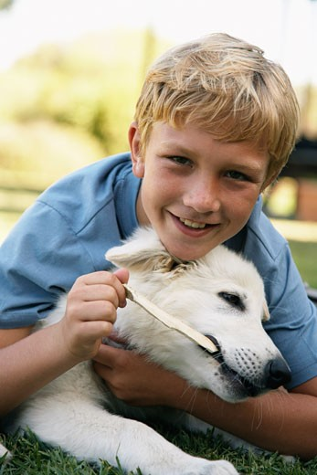 Stock Photo: 1828R-31154 Portrait of Boy With His Dog