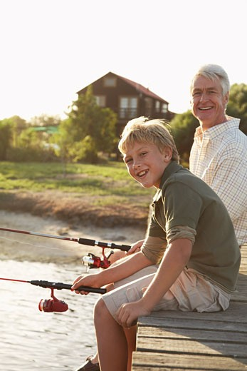 Stock Photo: 1828R-31171 Grandfather and Grandson Fishing