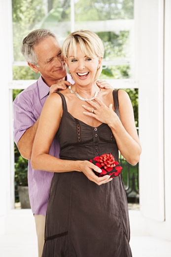 Man Giving Gift to Woman    : Stock Photo