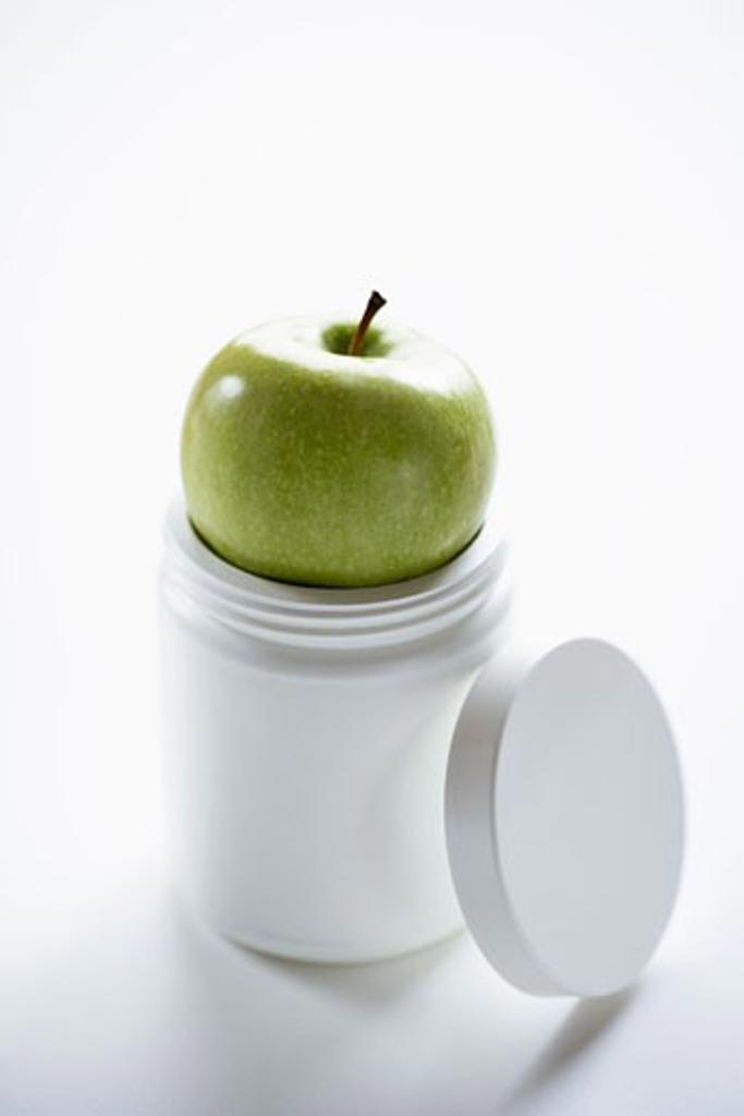 Stock Photo: 1828R-31581 Apple on Pill Bottle