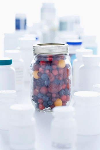 Jar Of Berries and Pill Bottles    : Stock Photo
