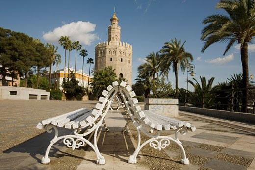 Stock Photo: 1828R-31731 Park Benches by Tower, Seville, Spain