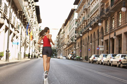 Stock Photo: 1828R-31748 Woman Jogging on Street