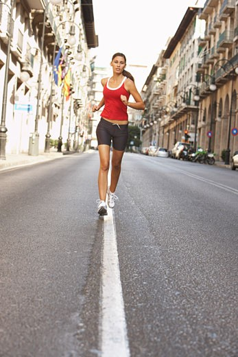 Woman Jogging on Street    : Stock Photo