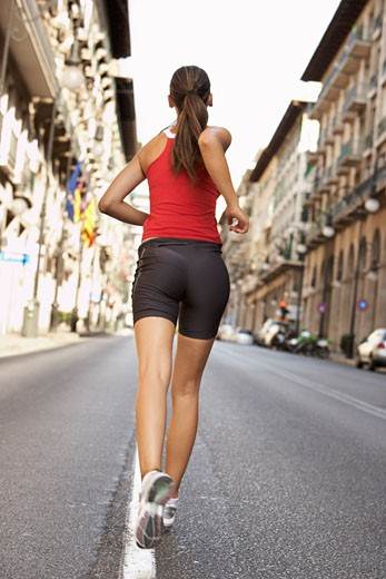 Stock Photo: 1828R-31750 Woman Jogging on Street