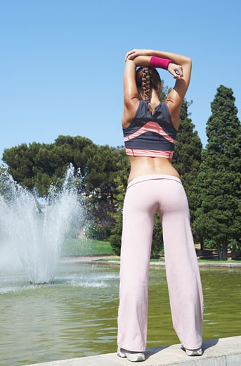 Woman Stretching at Park    : Stock Photo