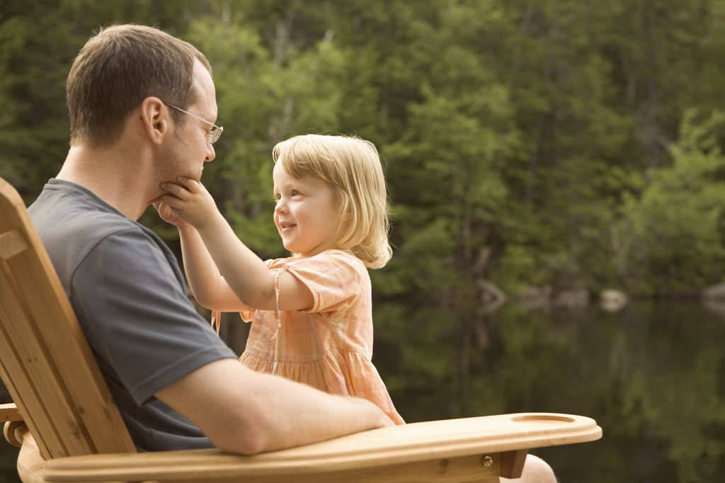 Stock Photo: 1828R-32033 Father and Daughter on Dock by Lake