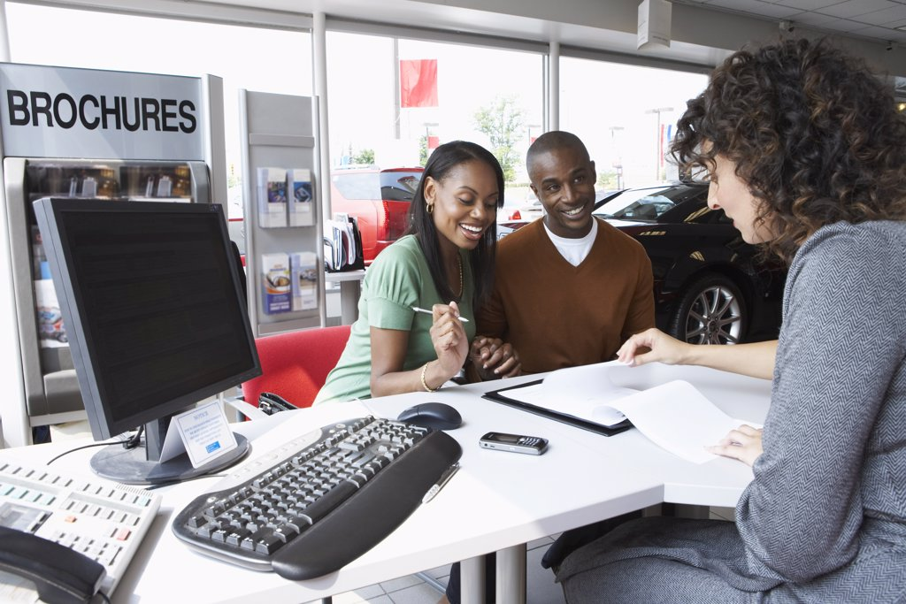 Stock Photo: 1828R-32335 Couple With Car Saleswoman