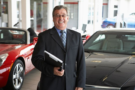 Stock Photo: 1828R-32345 Portrait of Car Salesman