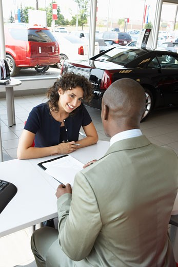 Stock Photo: 1828R-32354 Car Salesman and Client
