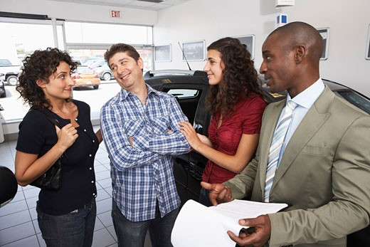 Stock Photo: 1828R-32365 Teenager and Family Shopping For New Car