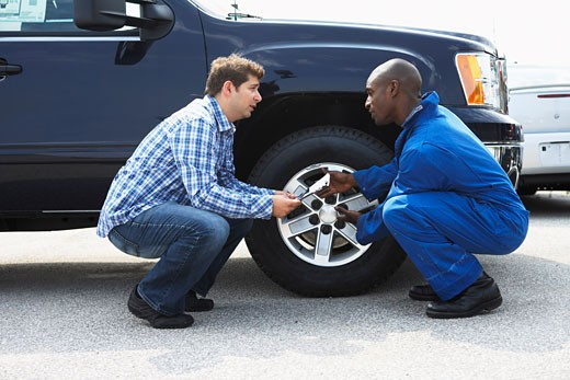 Mechanic and Client Looking at Truck    : Stock Photo