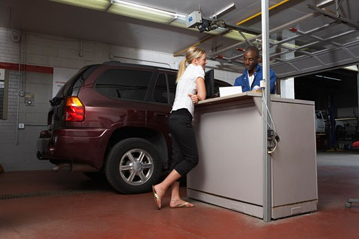 Stock Photo: 1828R-32385 Woman in Service Station