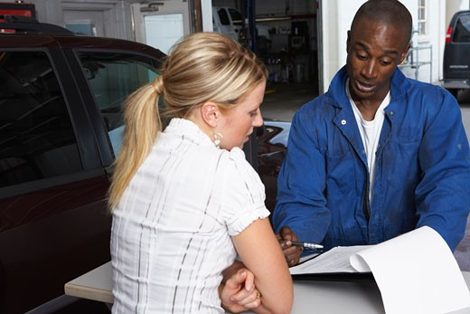 Woman and Mechanic in Service Station    : Stock Photo