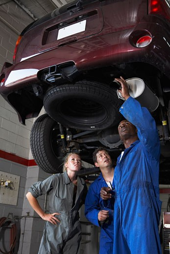 Stock Photo: 1828R-32399 Mechanics Working on Car