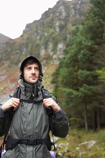 Stock Photo: 1828R-32868 Man Backpacking