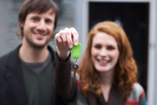 Couple with Key by House    : Stock Photo