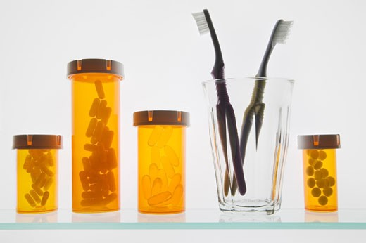 Pill Bottles and Toothbrushes : Stock Photo