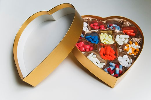 Heart Shaped Box Filled with Pills    : Stock Photo
