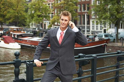 Businessman with Cellular Phone, Amsterdam, Netherlands    : Stock Photo