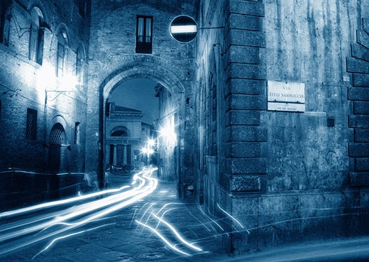 Stock Photo: 1828R-3340 Light Trails on Street at Night Siena, Tuscany, Italy