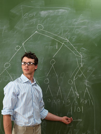 Teacher at Blackboard    : Stock Photo