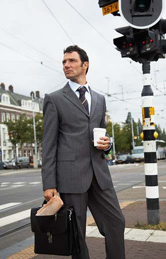 Stock Photo: 1828R-33657 Businessman by Intersection, Amsterdam, Netherlands