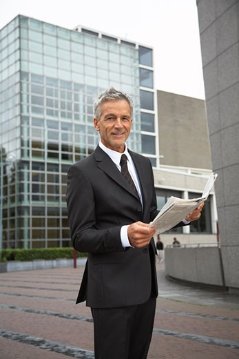 Businessman Reading Newspaper, Amsterdam, Netherlands    : Stock Photo