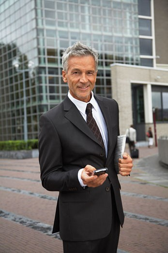 Businessman with Electronic Organizer, Amsterdam, Netherlands    : Stock Photo