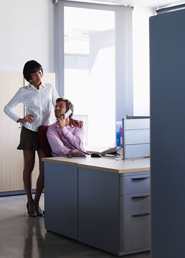 Stock Photo: 1828R-33724 Business People Flirting in Office