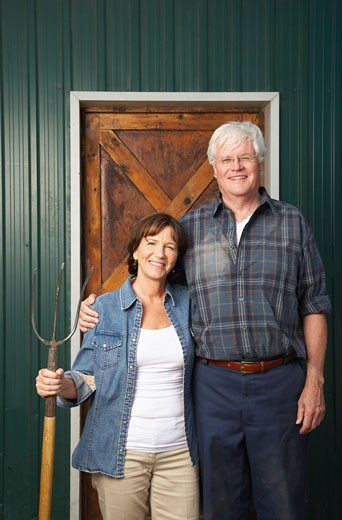 Stock Photo: 1828R-33828 Portrait of Couple by Barn