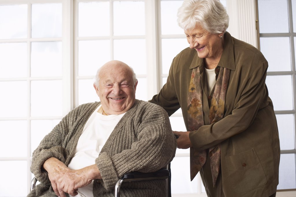 Senior Man Receving Assistance with Wheelchair    : Stock Photo