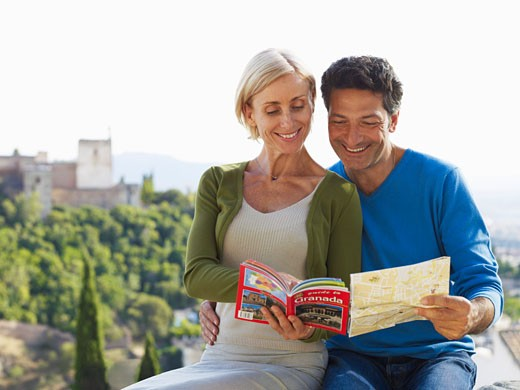 Stock Photo: 1828R-34123 Couple Looking at Map