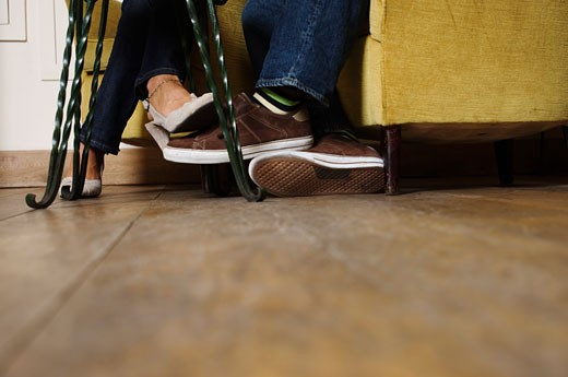 Stock Photo: 1828R-34201 Couple Playing Footsie
