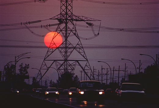 Stock Photo: 1828R-3431 Traffic at Sunset with Power Lines St. Bruno, Quebec, Canada