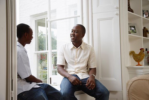 Stock Photo: 1828R-34667 Father and Son Talking