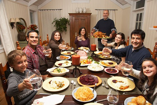 Stock Photo: 1828R-34818 Family Toasting at Thanksgiving Dinner