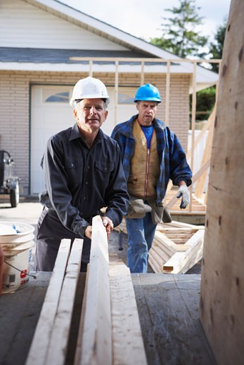Construction Workers Building Addition on Home    : Stock Photo