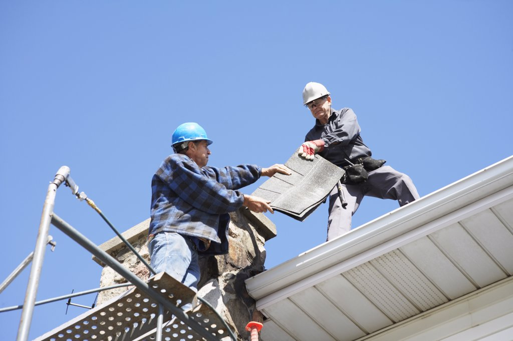 Stock Photo: 1828R-34894 Men Working on Roof