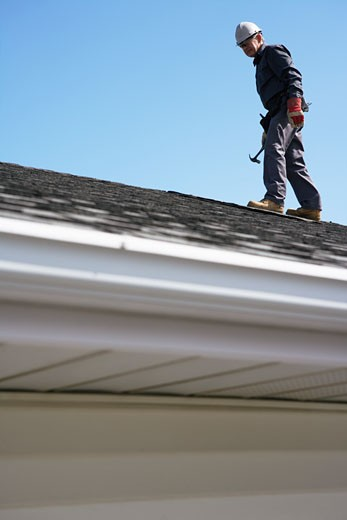 Stock Photo: 1828R-34897 Man Working on Roof